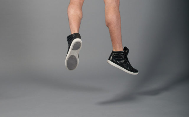 stokpic Mens shoes Jumping Grey Background